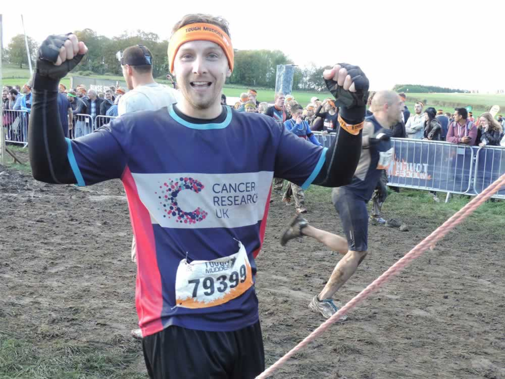 Calum crosses the line after completing the Tough Mudder