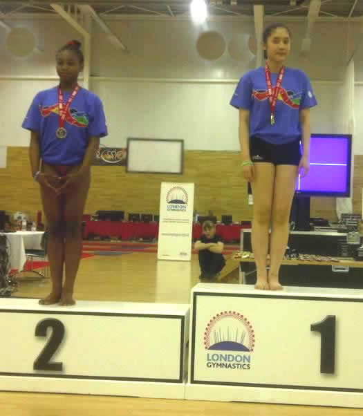 Celeste and Quinh with their Floor medals
