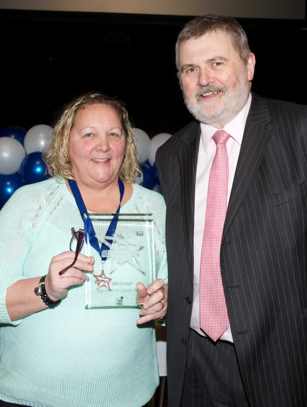 Shirley with her Service to Sport Award