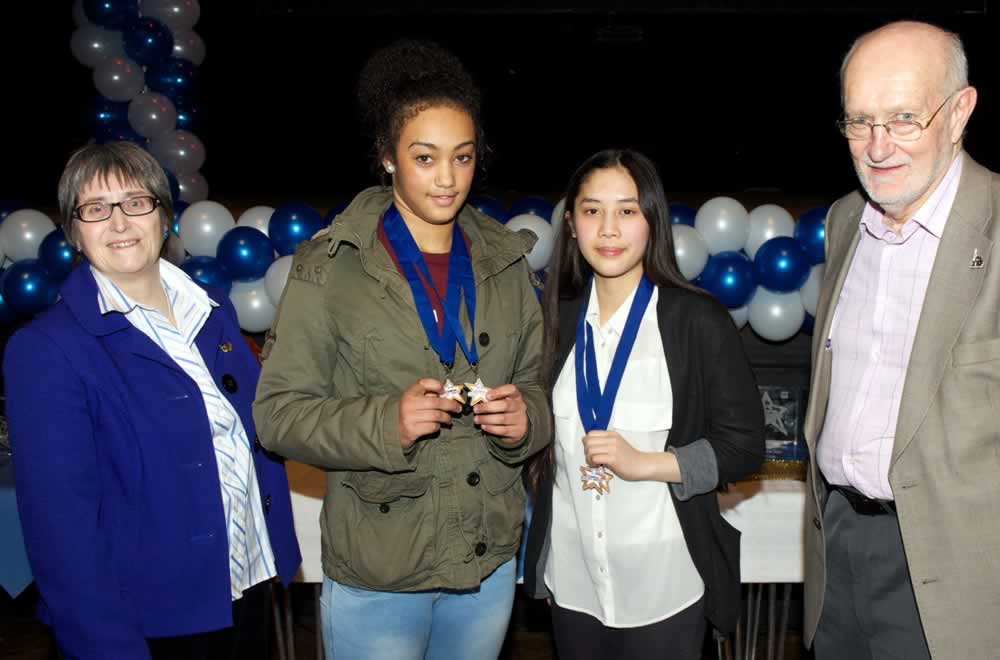 Maisie and Quynh with their Gold Medal Awards